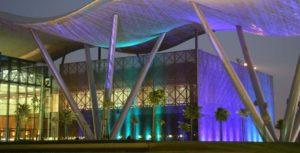 Copyright Aurecon Qatar Science Technology Park, building, purple glowing light, roof, trees